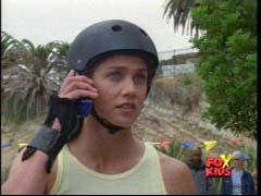 Kelsey Winslow (Yellow Ranger) gets a call while rollar blading